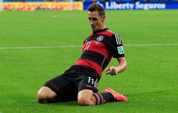 Miroslav Klose celebrates record-breaking goal (SOURCE: AFP)