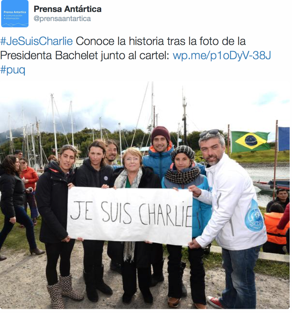 "Chilean President Michelle Bachelet (center) poses with ""Je Suis Charlie"" sign in Port Williams, Chile."