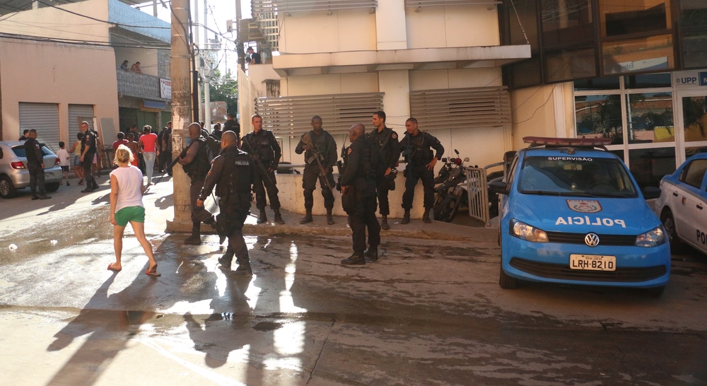 Military police unit's elite squad, known as BOPE, patrol pacifying police units in Alemão. Photo by Flora Charner