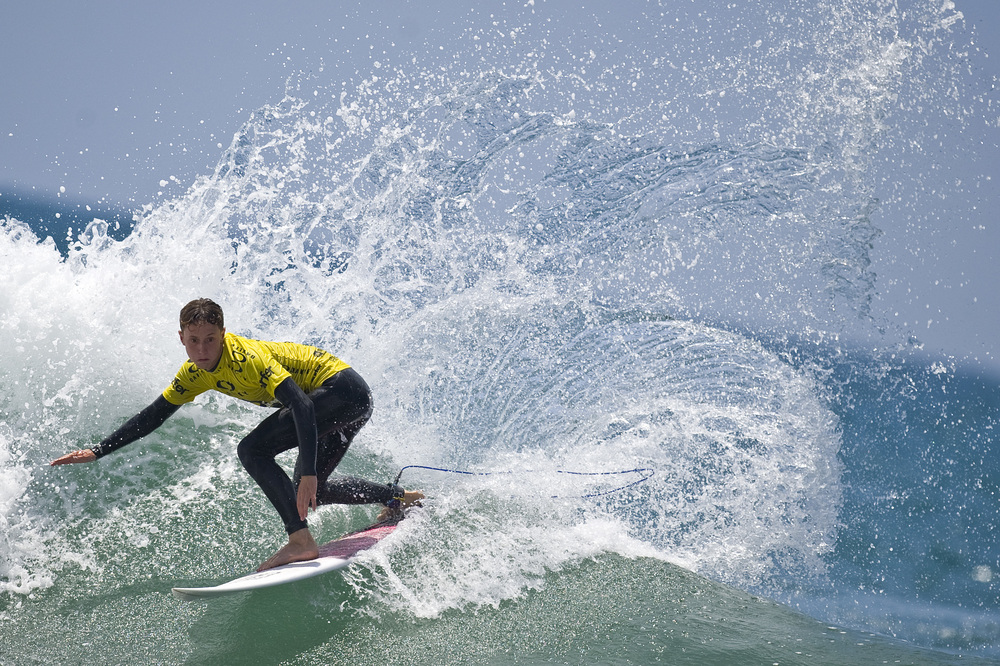 NEWPORT BEACH, CA   Taylor Curren, surfing for Revolution, does three turns on a wave during his attempt in the Oakley Surf Shop Challenge. Revolution would go on to win first place and win a trip to Bali.