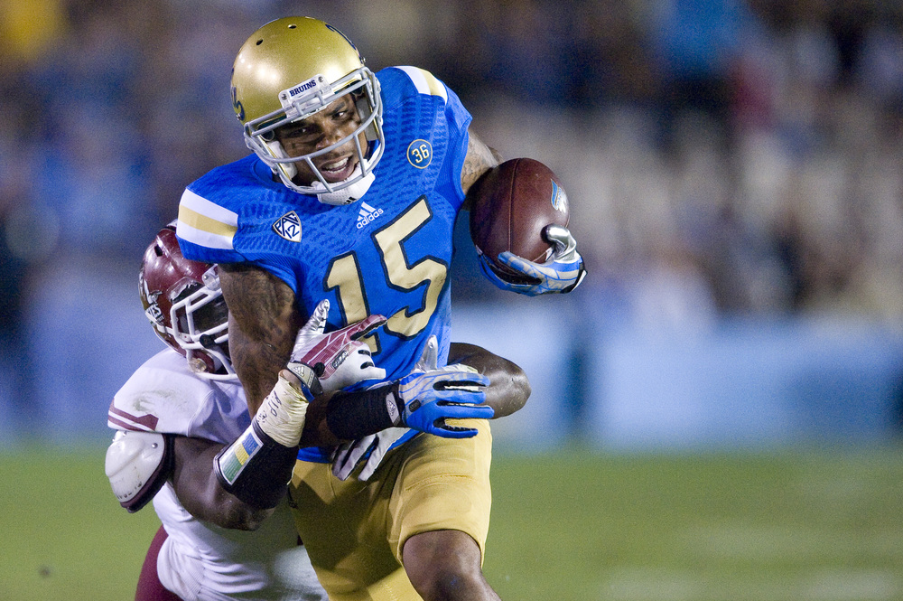PASADENA, CA   Redshirt sophomore wide receiver Devin Lucien catches a pass from quarterback Brett Hundley, which would set up the following UCLA score.