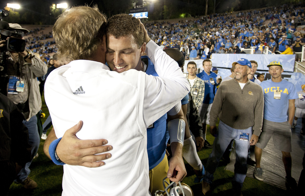 PASADENA, CA   Former UCLA Head Coach Rick Neuheisel and Quarterback Kevin Prince share a hug after defeating the Washington State Cougars, 28-25.