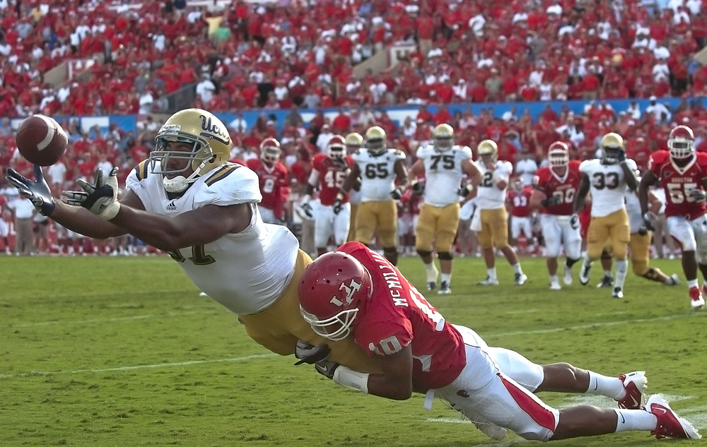 HOUSTON, TX   UCLA tight end Cory Harkey reaches out for what would later be ruled as an incomplete pass.