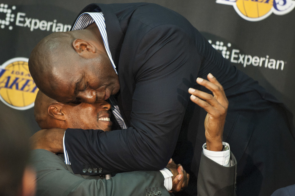 "LOS ANGELES, CA    Former Los Angeles Lakers player Earvin ""Magic"" Johnson hugs and congratulates Byron Scott, the new head coach for the Lakers."