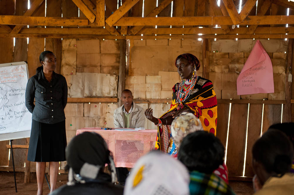 A Justice trainee practices her public speaking skills,   guided by Justice Project staff.  Photo: Landesa/Deborah Espinosa