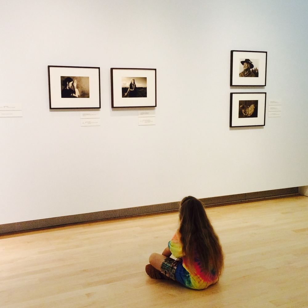 A young patron of the Tacoma Art Museum pauses to contemplate Project 562. Photo: Deborah Espinosa.