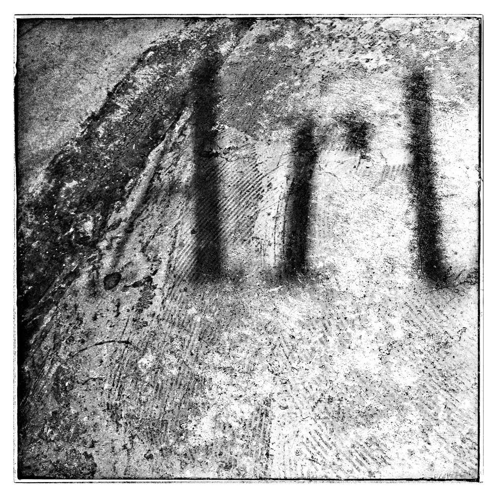 """""""Art"""" as a shadow on a concrete floor.  Copyright Deborah Espinosa."""