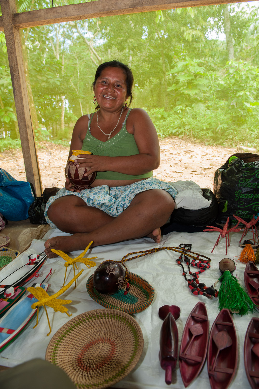 Local women display their traditional crafts for sale to eco-tour participants. Such income is critical to the families of Puerto Prado.