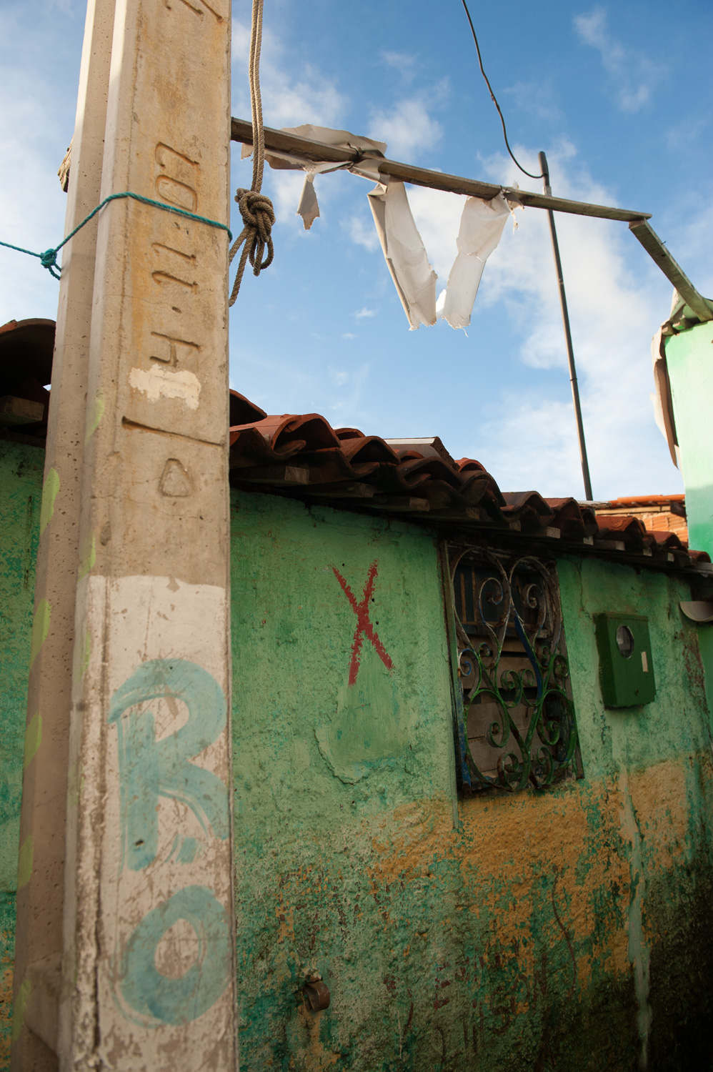 A modest favela (slum) home in the City of Fortaleza is tagged for demolition, the only notice that the City of Fortaleza gives residents of its plans to demolish the home.