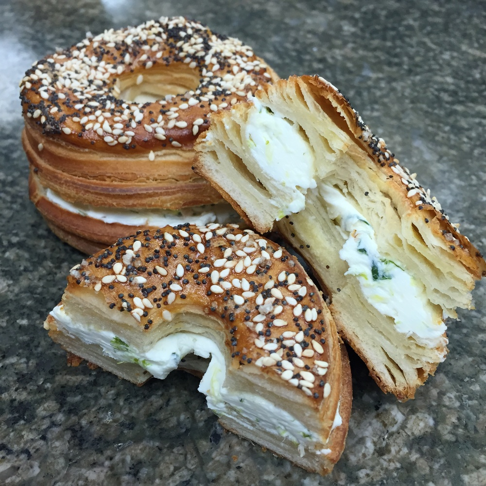 FRENAGEL (tm) The French Croissant Bagel. Created and sold exclusively here at fiorello dolce. Flavors include Scallion Cream Cheese with Fleur de Sel, Poppy and Sesame seeds. Maple Walnut with Cinnamon Raisin Cream Cheese. Black Sesame seeds, Fleur de Sel and Vegetable Cream Cheese.