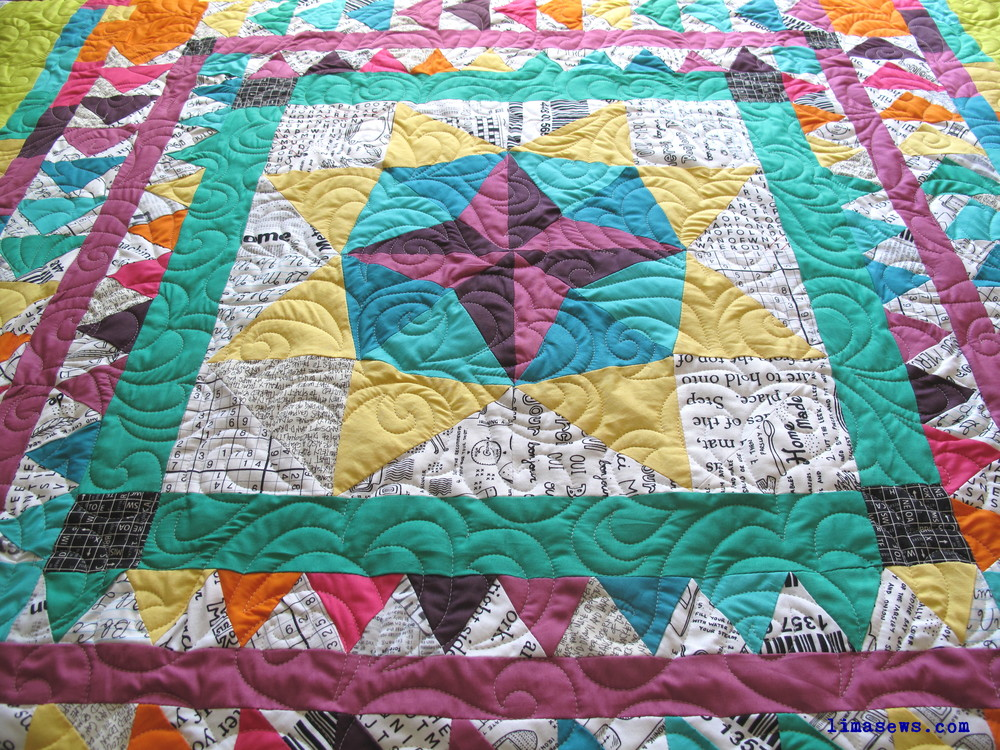 """Quilted with """"Oh My Feathers"""" pattern; Pieced by Sara L."""