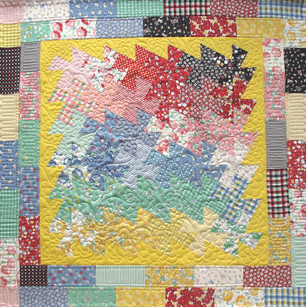 Quilted with freehand floral pattern; Pieced by Sara S.