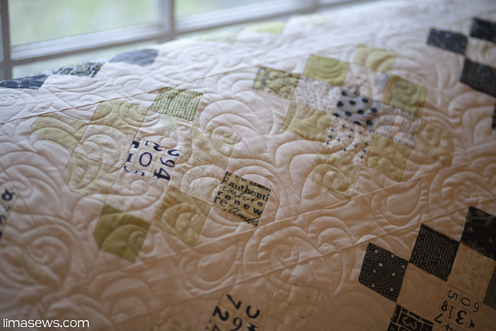 "Quilted with ""Oh My Feathers"" pattern; Pieced by Anna L."