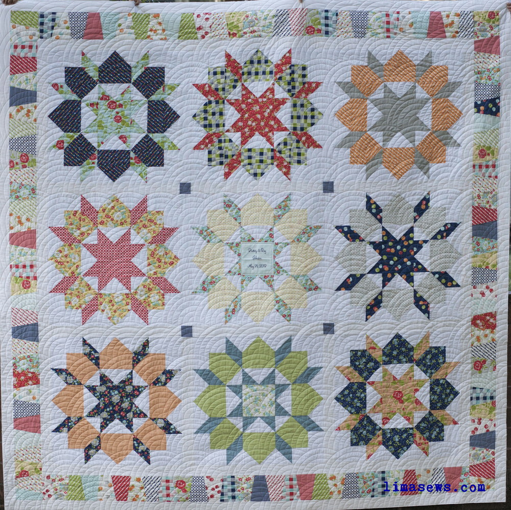 Quilted with freehand baptist fan; Pieced by Jennifer G.