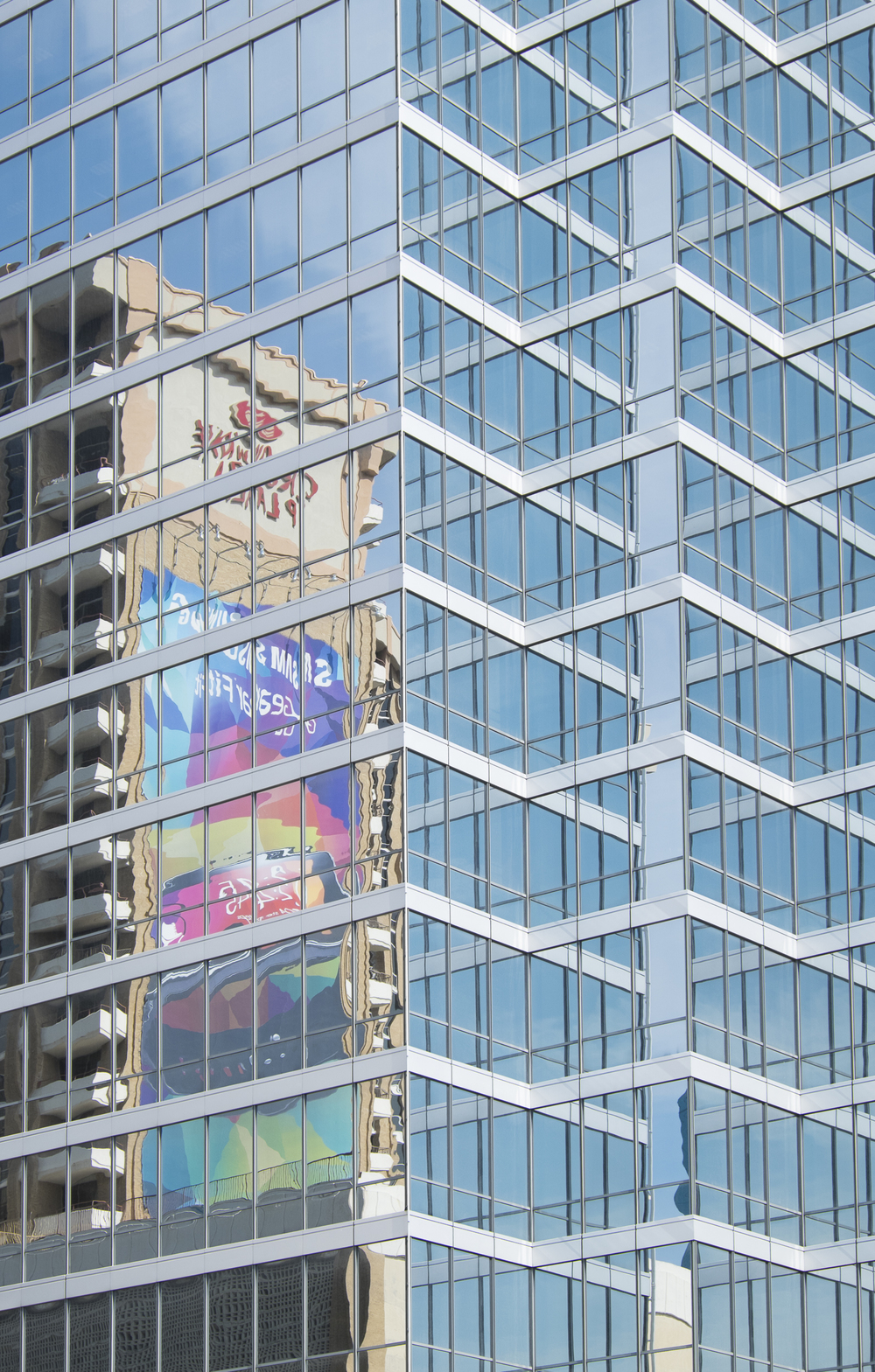 Dallas skyscraper provides colorful reflections.