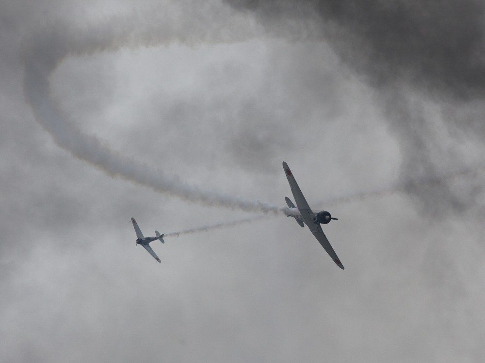 Japanese Zero aircraft fighters swoop in smoke patterns during the Pearl Harbor re-enactment, Alliance Air Show, near Fort Worth, TX, USA