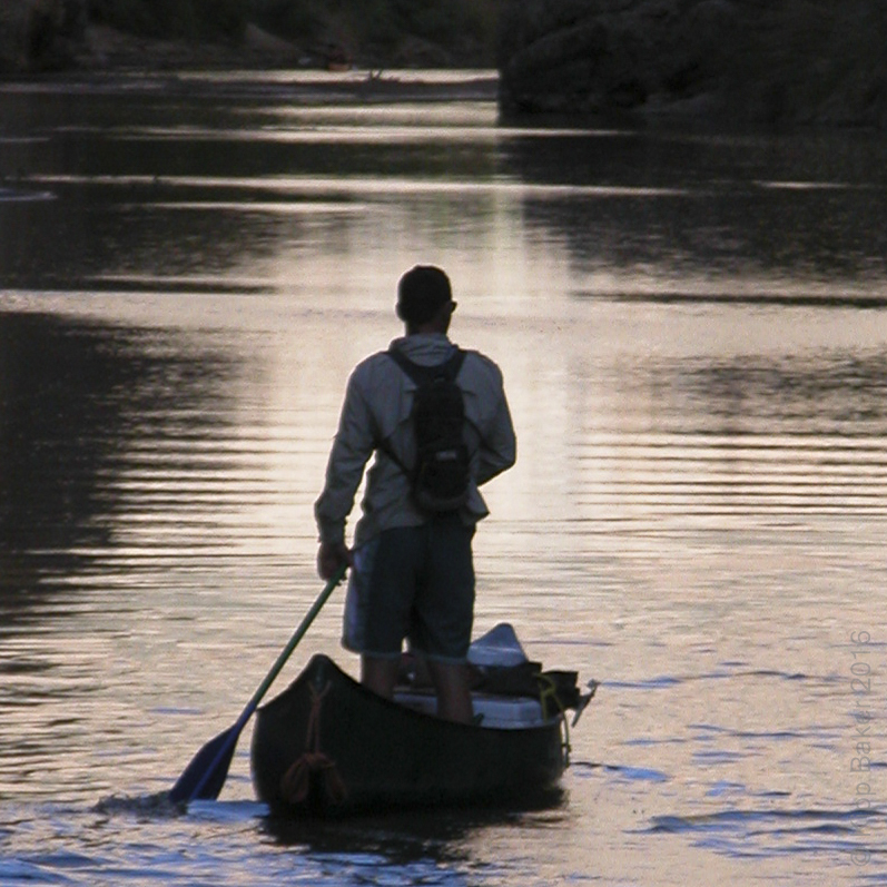 Canoe tourmaster leads the way on the Rio Grande and into Santa Elena Canyon, Big Bend National Park