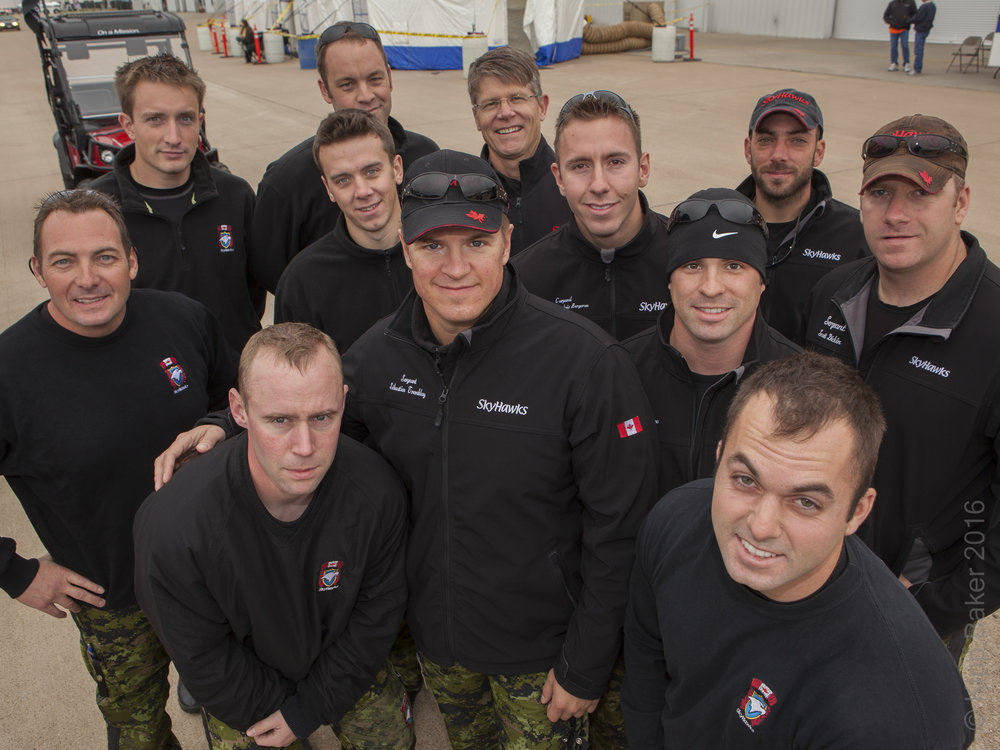 Shot for   Bell Helicopter internal marketing campaign showing CEO John Garrison (back row with glasses) posing with parachuting jump team - Alliance Air Show.