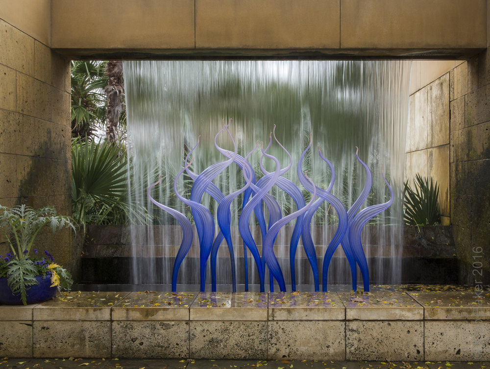 Chihuly Glass installation with waterfall at Dallas Arboretum