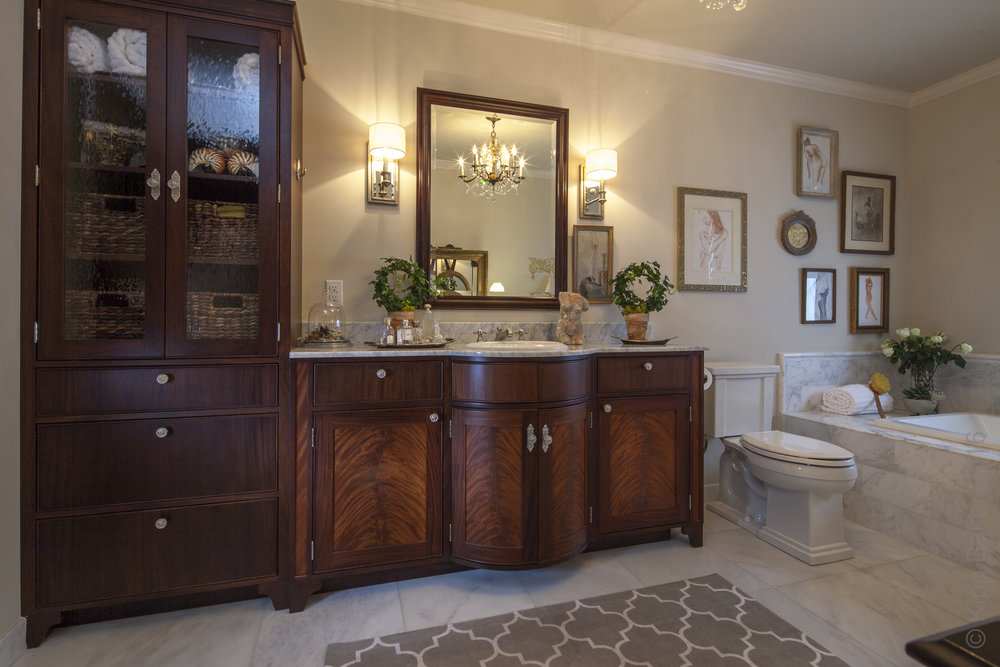 Barrel door bathroom vanity  -   Reznikoff Custom Furniture millwork and cabinetry  .