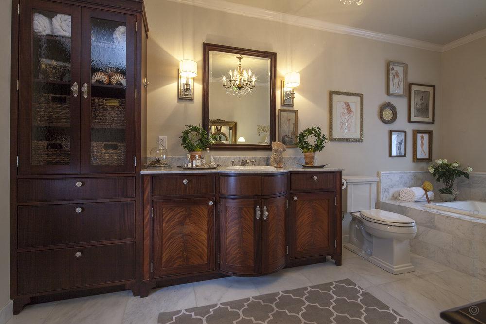 Barrel door bathroom vanity -  Reznikoff Custom Furniture millwork and cabinetry  .