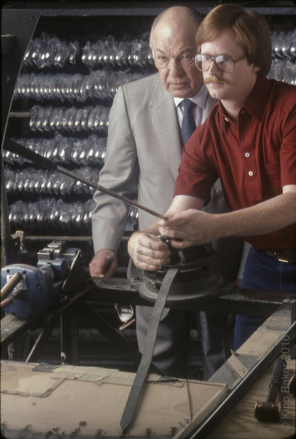 "The late golf great, Mr. Ben Hogan inspecting clubs at the ""loft & lie"" machine."