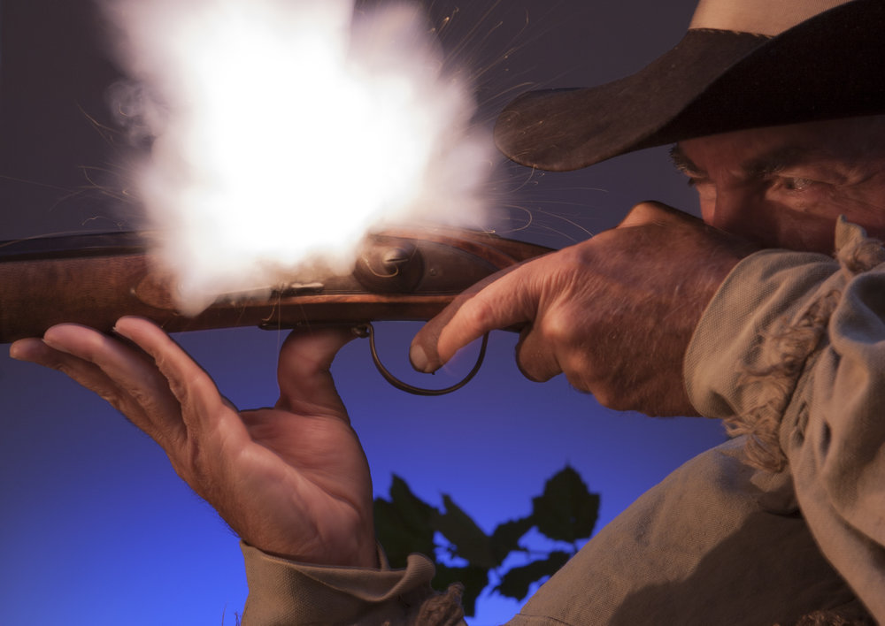 Pioneer Hunter Fires Black Powder Musket