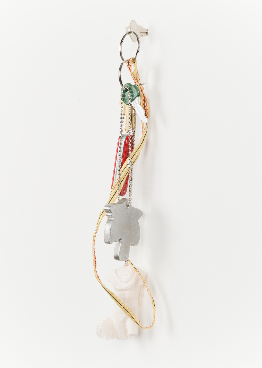 "Chris Bradley  Token (Palm #2)  2013   Cast aluminum, wood, PLA, kevlar, key rings, chain   15"" x 4"" x 3"" CB055"