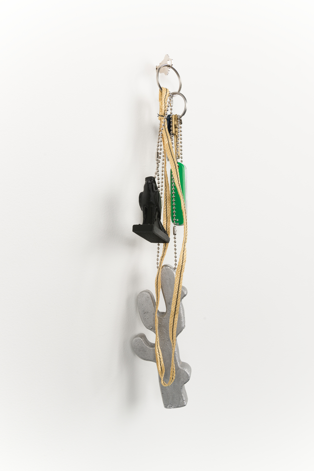 "Chris Bradley  Token (Cactus)  2013 Cast aluminum, wood, PLA, Kevlar, key rings, chain  17"" x 4"" x 3"" CB054"
