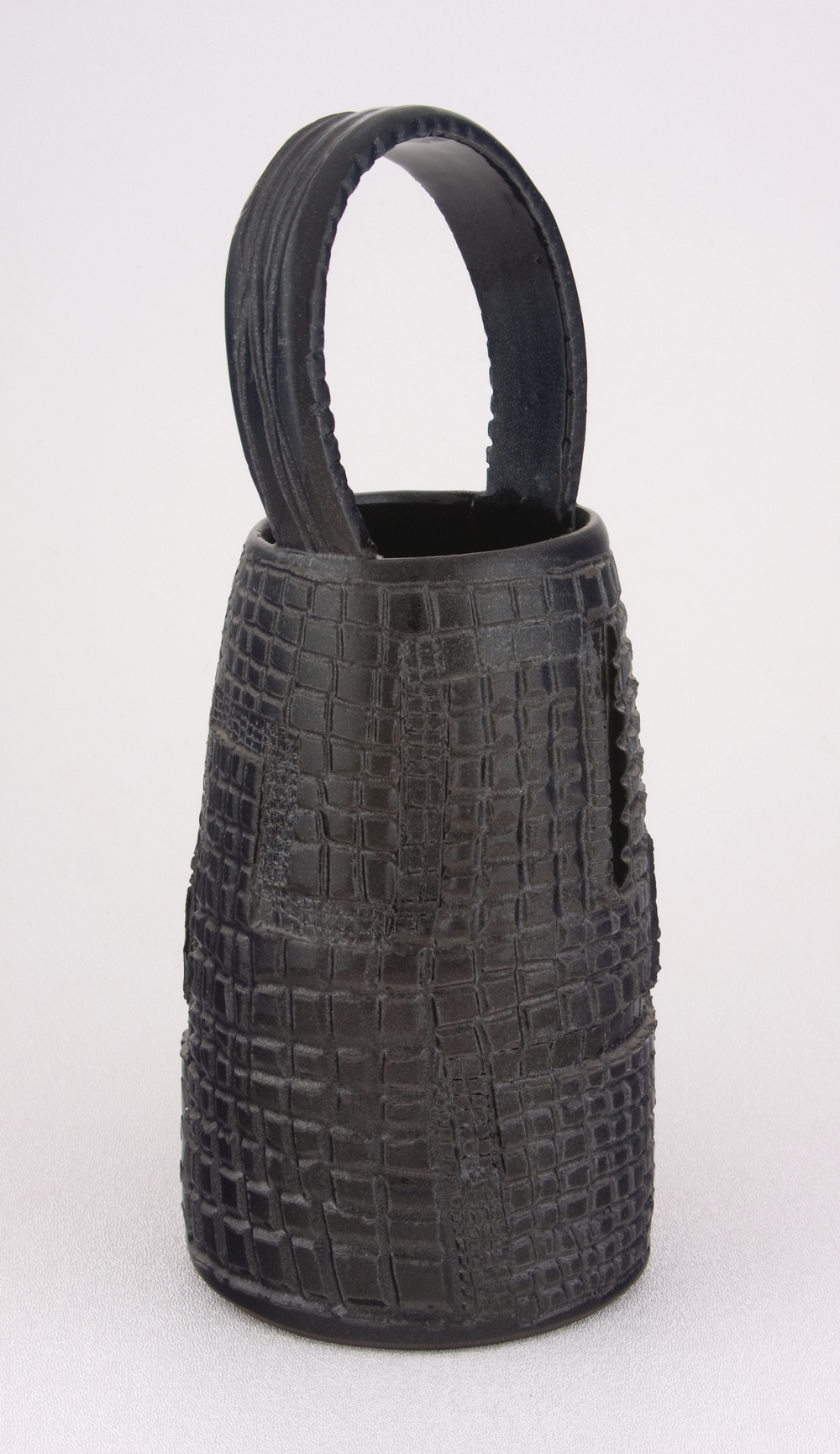 Shio Kusaka  Untitled (clay basket 1)  2005 Stoneware 10 3/4h x 4 1/2w x 4 1/2d in SK001