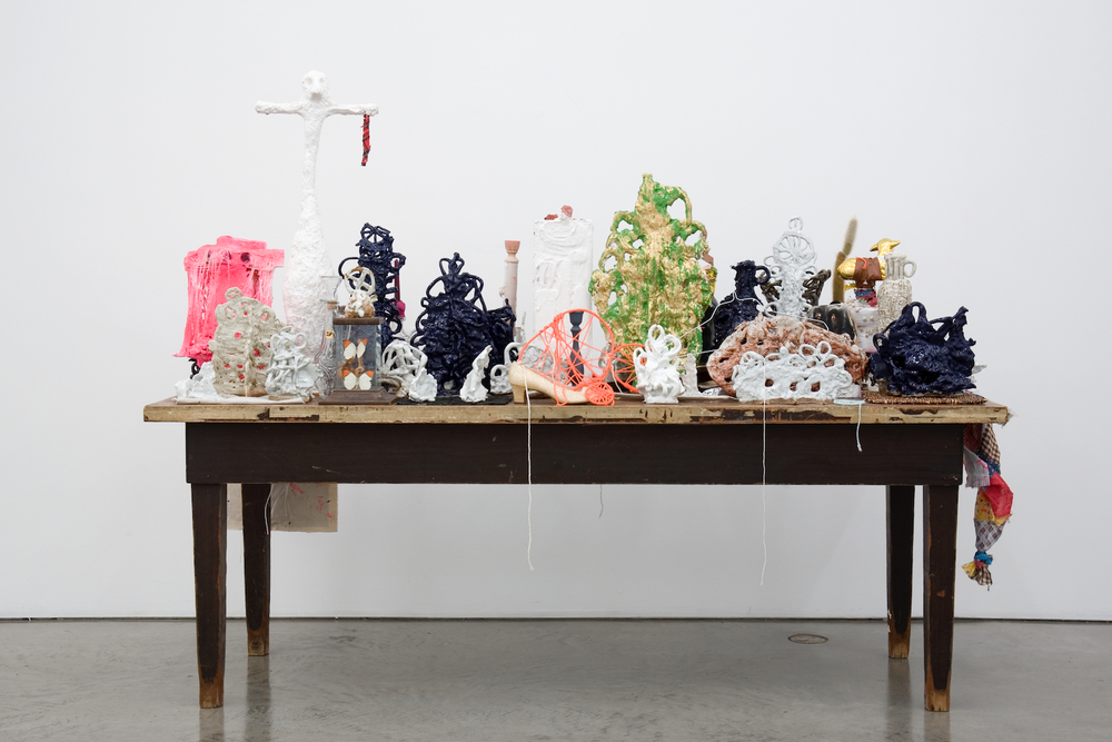"William J. O'Brien  Cinaedus Table, MDCCLXXV  2007   Glazed ceramic, found objects, plaster, unfired clay, fabric, string, and mixed media on found table   65"" x 84"" x 30"" WOB116"