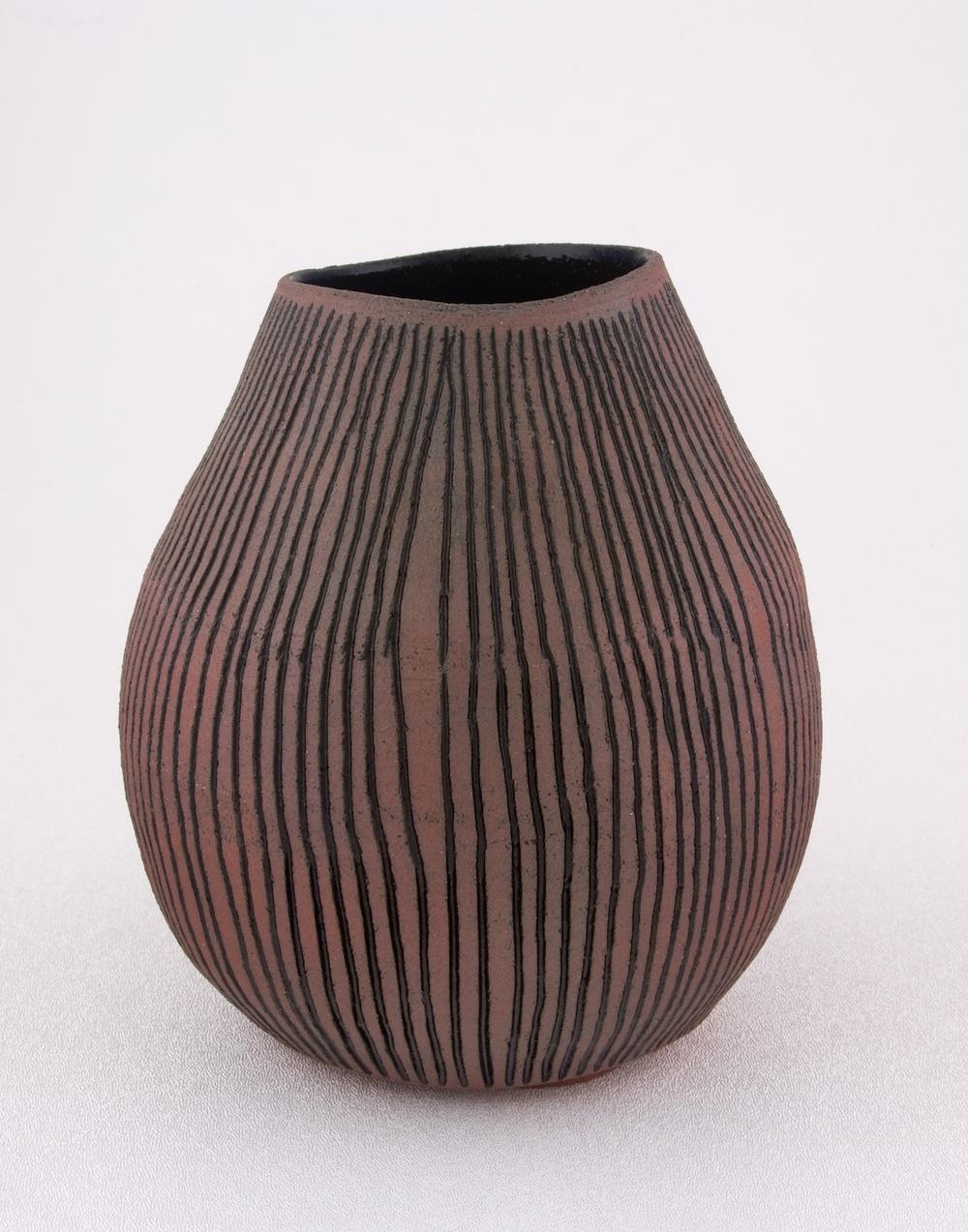 Shio Kusaka  Untitled (carved stripe 3)  2009 Porcelain 6 ½h x 6 ½w in SK023