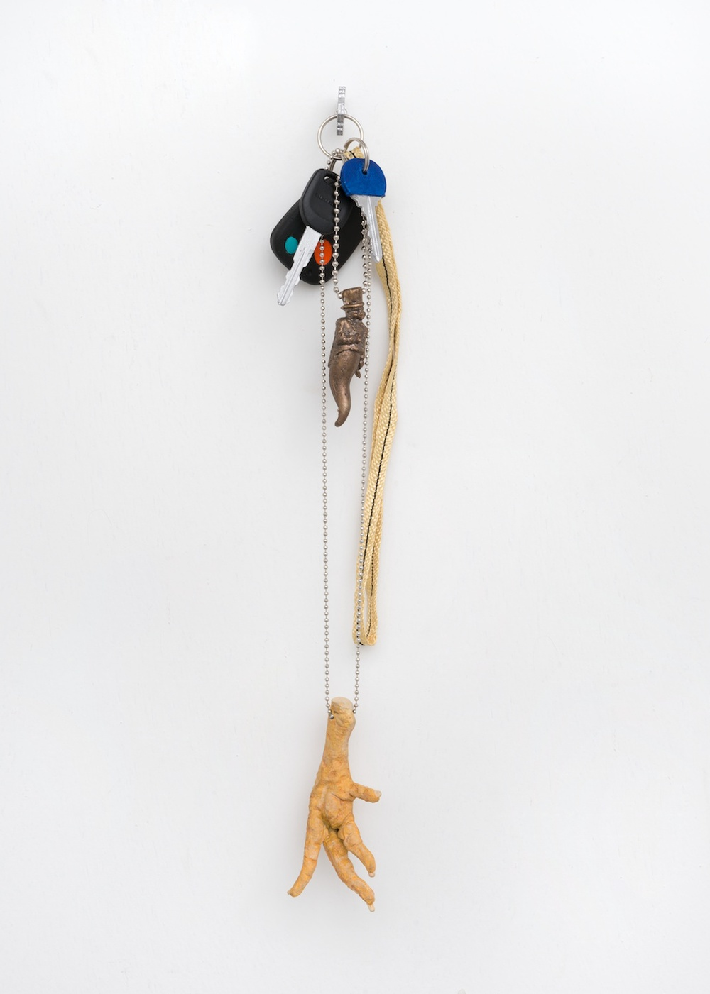 "Chris Bradley Token (Chicken) 2014 Acrylic on cast plastic and cast bronze, strap, keyring, and chain 16 ¼"" x 3"" x 2"" CB074"