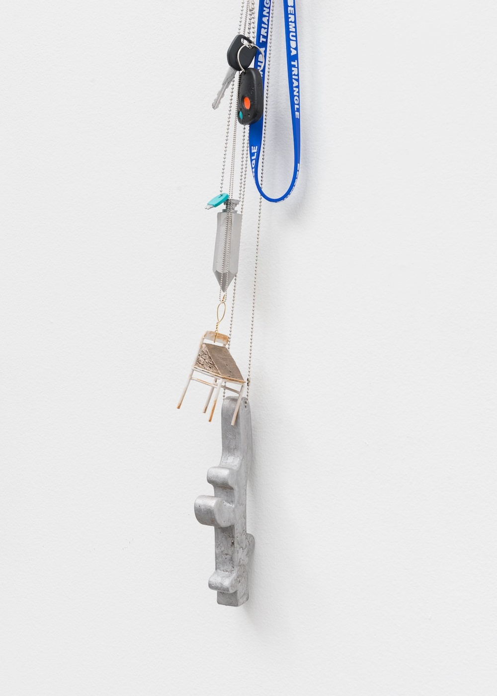 Chris Bradley  Untitled Token  2015 Acrylic paint on cast bronze, acrylic paint on steel, wire, key rings, painted wood, ball chains, hardware 52h x 6w x 4d in CB141