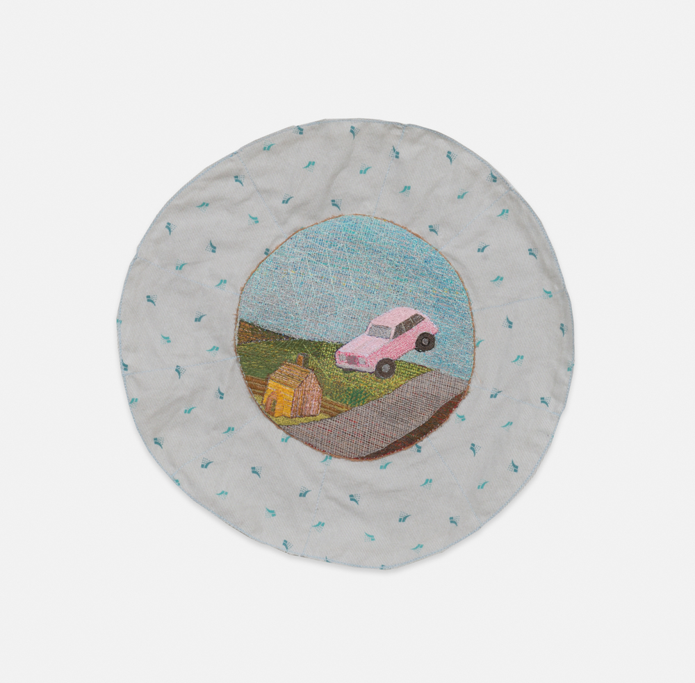 Chuck Jones  We no longer have the words to express how screwed we are.  2016 Polyester, cotton, and silk embroidery on cotton mounted on hospital gown 14 1/4 in diameter CJones002