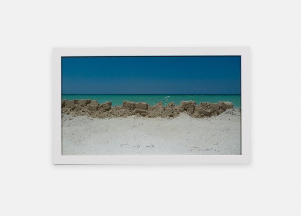 Eliza Myrie  Sandwall, Negril  2015 Digital photograph 8 7/16h x 15w in (artwork); 10h x 17w in (framed) 1 of 3 EM002