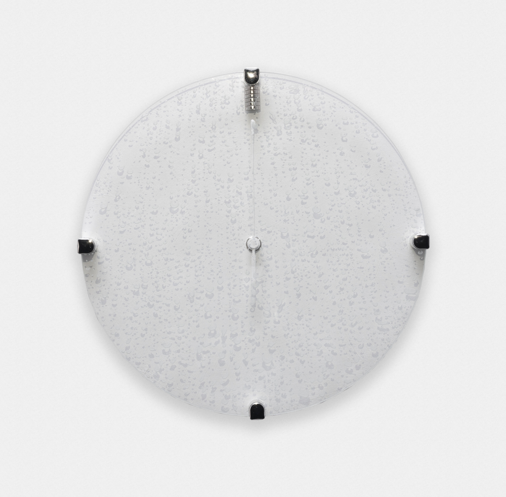 Greg Bae  It Shall All Be Mine (1)  2016 Magnetized atomic clock, magnets, acrylic and engraving on glass 10 1/2 in diameter GB001