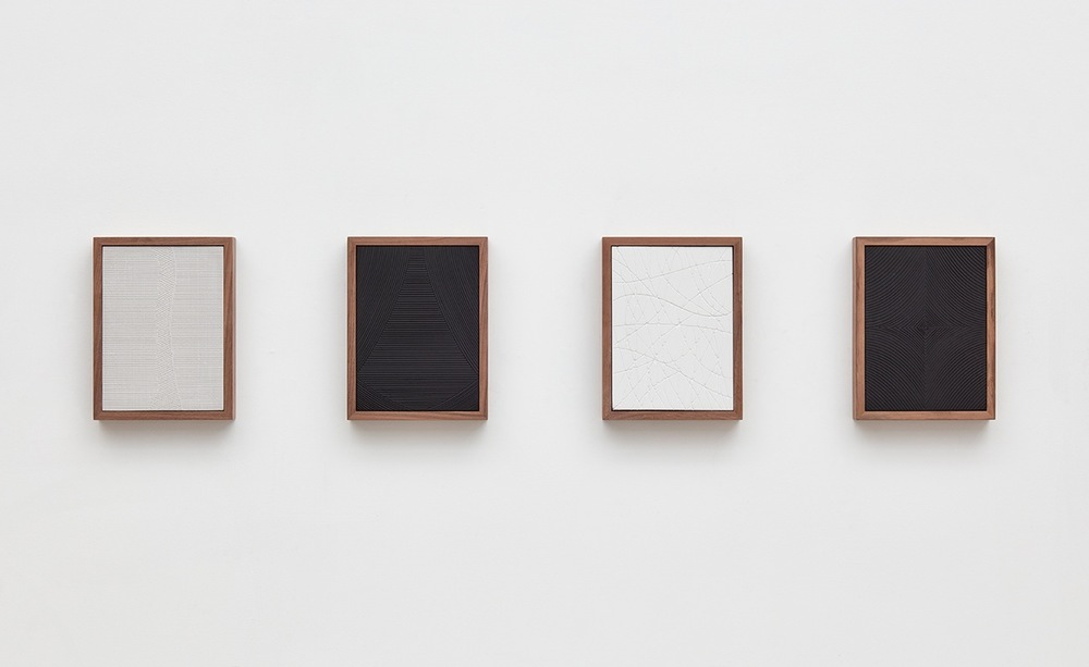 Anthony Pearson  Untitled (Four Part Etched Plaster)  2016 Medium coated and pigmented hydrocal in four walnut frames Each 10 1/2h x 8w x 1 3/4d in, overall 10 1/2h x 51 1/2w x 1 3/4d in AP433