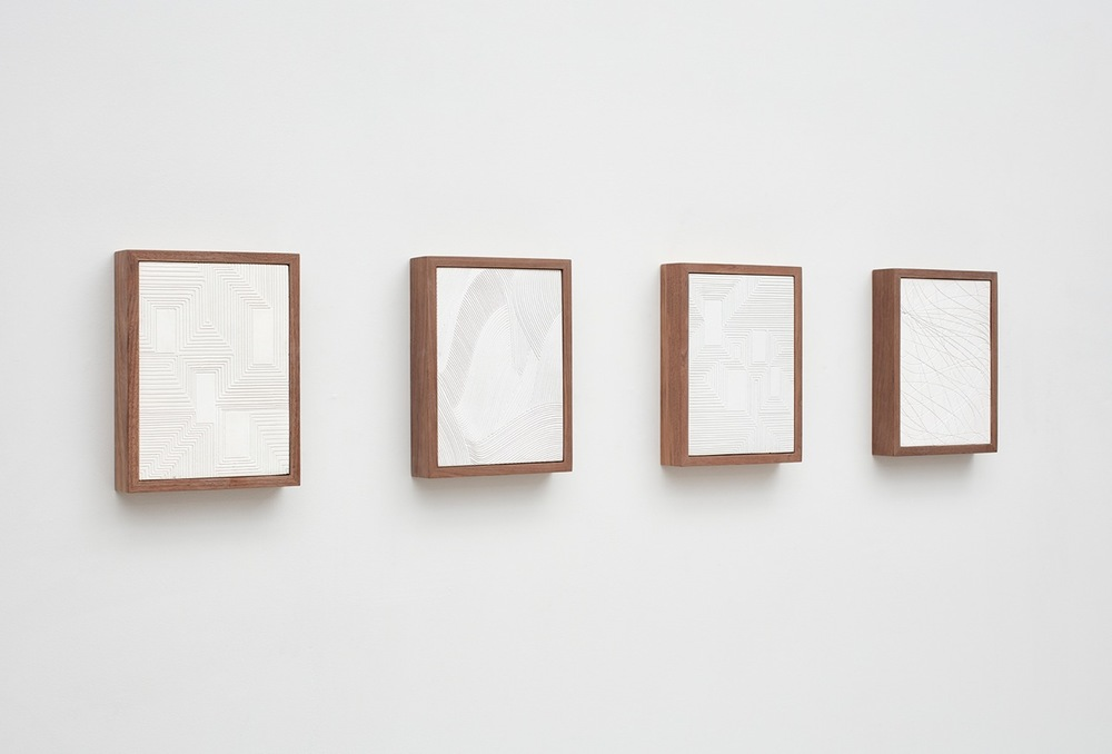Anthony Pearson  Untitled (Four Part Etched Plaster)  (Alternate view) 2016 Pigmented hydrocal in four walnut frames Each 10 1/2h x 8w x 1 3/4d in, overall 10 1/2h x 51 1/2w x 1 3/4d in AP435