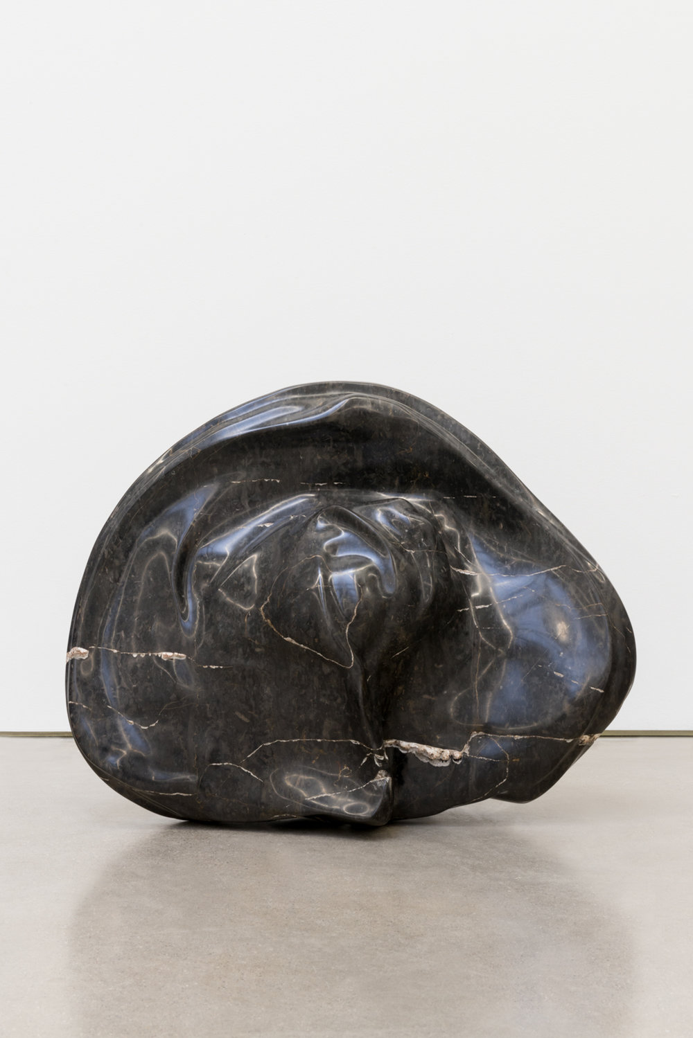 Alma Allen  Not Yet Titled , 2016 Found black marble 18h x 22w x 9d in AA049