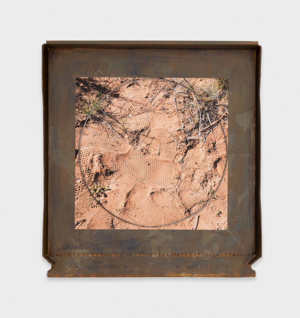 Chris Bradley Grease Face (Ojo Caliente) 2017 Patinated steel, aluminum, cast bronze, ink jet print on vinyl, hub cap ring, and lacquer 21.25 x 19.5 x 2 in (53.98h x 49.53w x 5.08d cm) CB246
