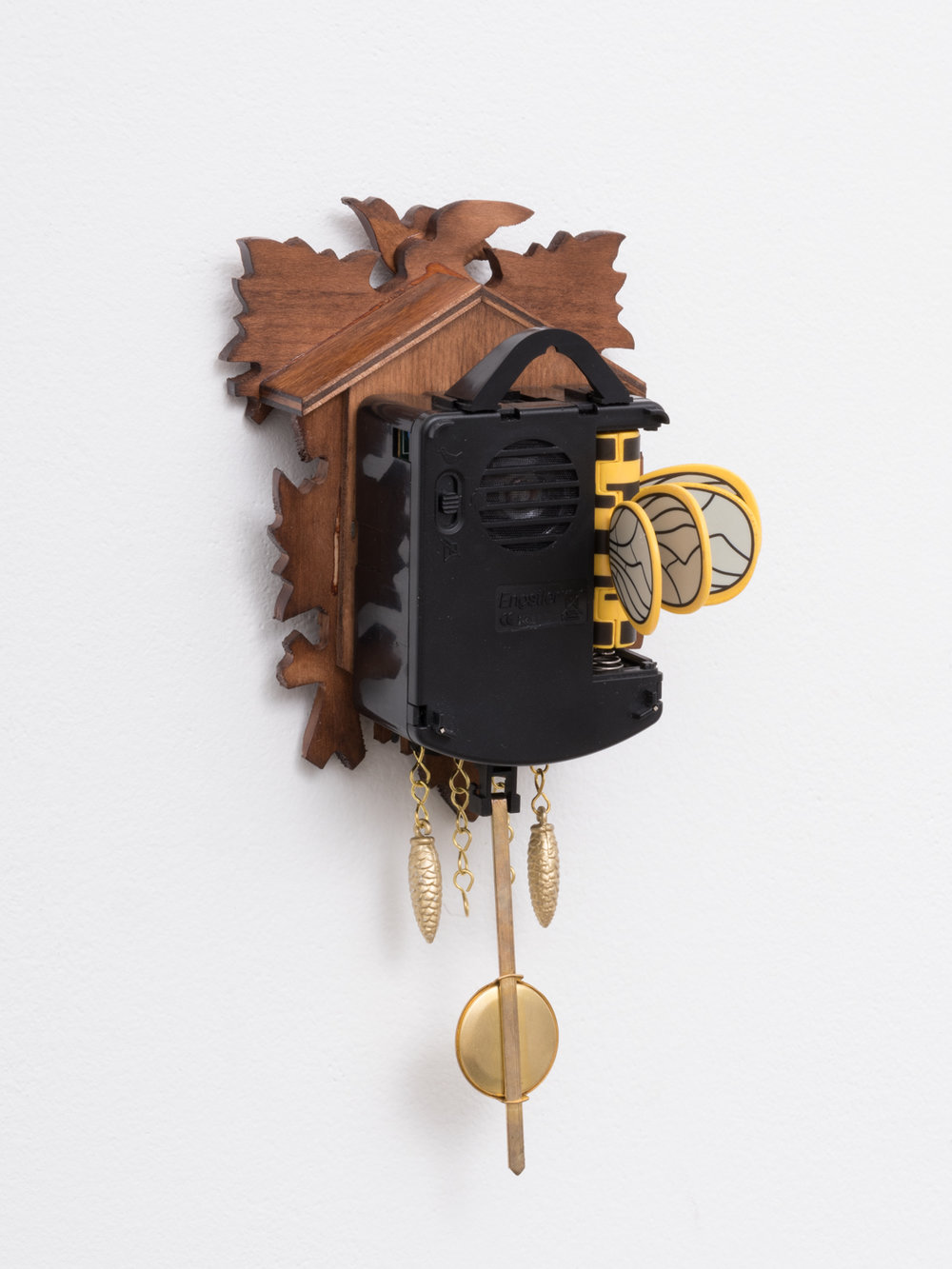 Chadwick Rantanen  Age-Old Bird and Leaf  2017 Battery operated cuckoo clock, 2 artist-made AA battery adaptors (plastic, metal, stickers) 9 ½h x 8w x 4d in CR043