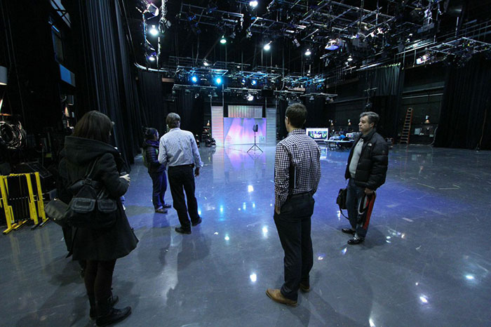 Production team discussing potential plans during a site visit at the CBC. (Photo: Nicholas de Pencier)