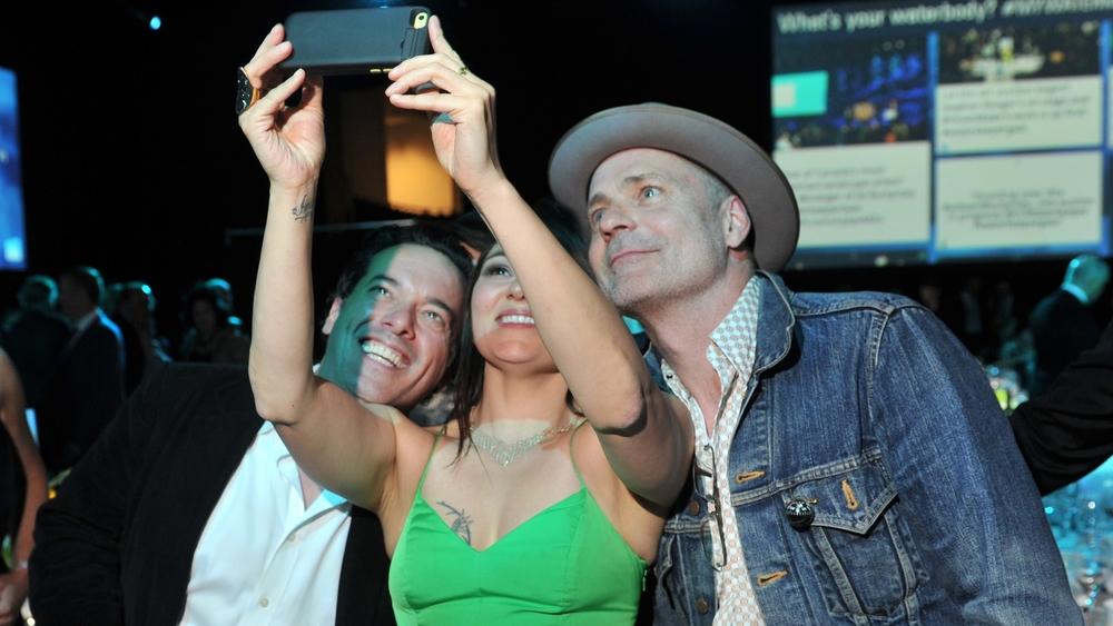 Joseph Boyden, Tanya Tagaq and Gord Downie pose for an impromptu group photo at the Waterkeeper Gala in Toronto.