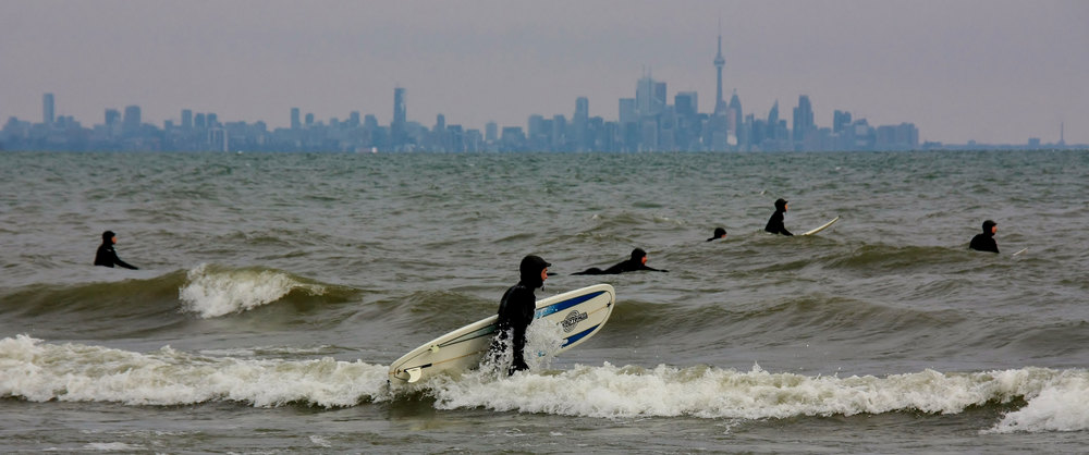 Toronto surfers looking for white caps by the mouth of the Humber River. (Photo via Frances Maas RECE)