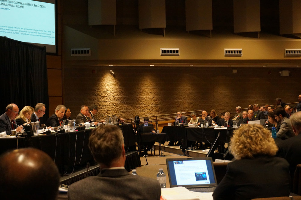 Waterkeeper (right) presenting to the CNSC (left) while OPG representatives and CNSC staff look on. (Photo by Lake Ontario Waterkeeper)