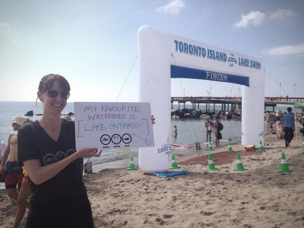 Krystyn showing her love for her favourite waterbody at the 2013 Toronto Island Lake Swim. (Photo via Lake Ontario Waterkeeper)