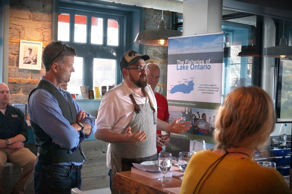 Speakers at the first Eating Lake Ontario event (l-r): The Ministry of Natural Resources' Colin Lake looking on from the back, the Water Access Group' David MacDonald, Dianne's Fish Shack's Chef Paul Dubeau, and Three Dog Winery's John Squair.