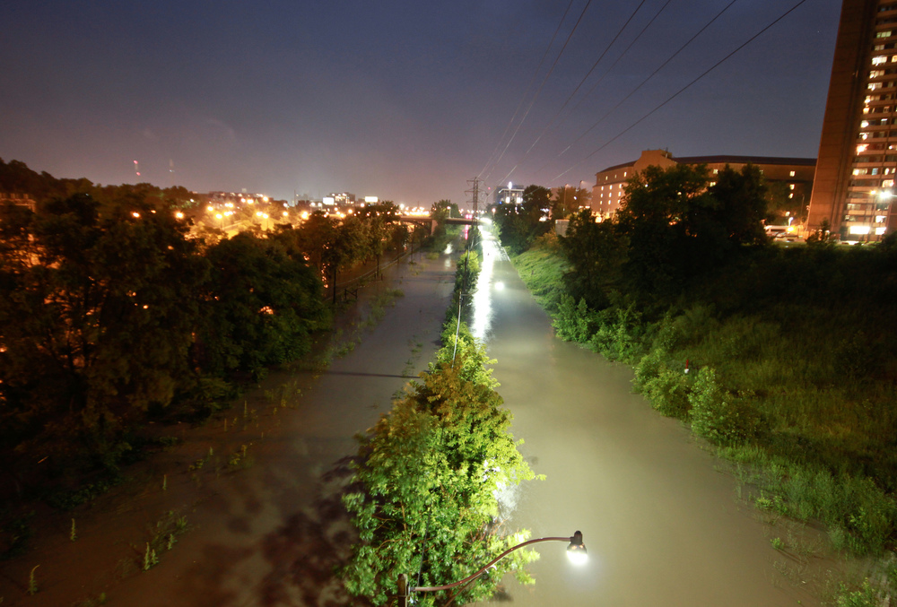 An overwhelmed Don River floods Bayview Avenue and the southern end of the Don Valley Parkway caused by the summer storm of July 2013. (Photo by Roozbeh Rokni.)
