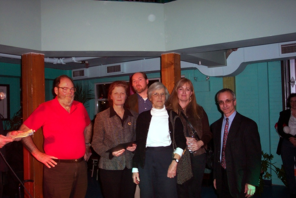 Pat Lawson (centre) being inducted into the Lake Ontario Hall of Fame with Port Hope residents at Waterkeeper's first office in Bambu by the Lake, 2003.